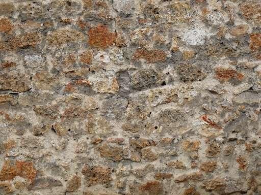 texture ressemblant à un mur de pierre avec des lichens oranges
